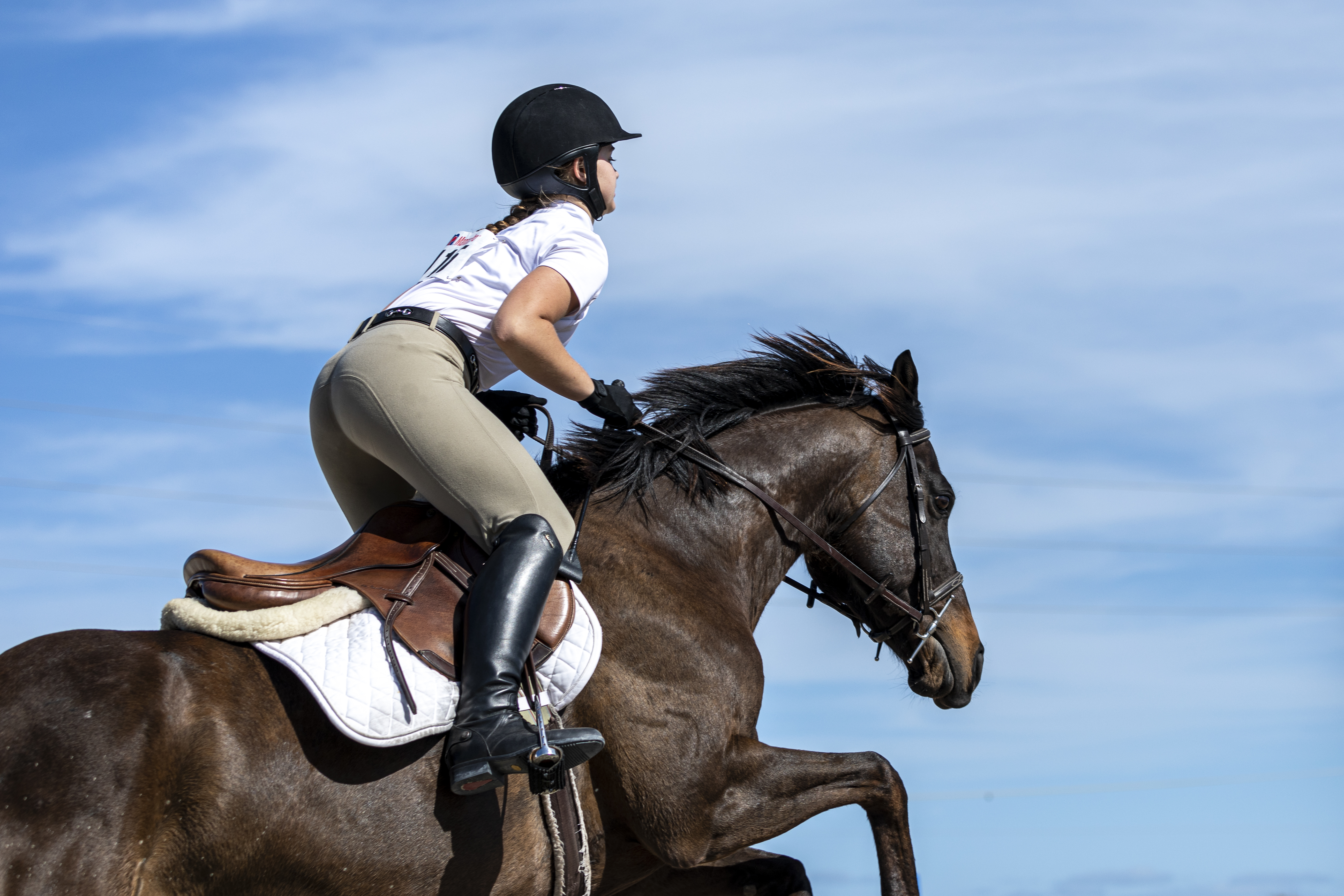Brevard Equestrian Center participant in jump position on her horse during an equestrian show in 2021.