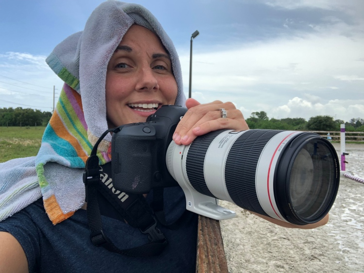 Alexa photographing an equestrian event during intermittent rain